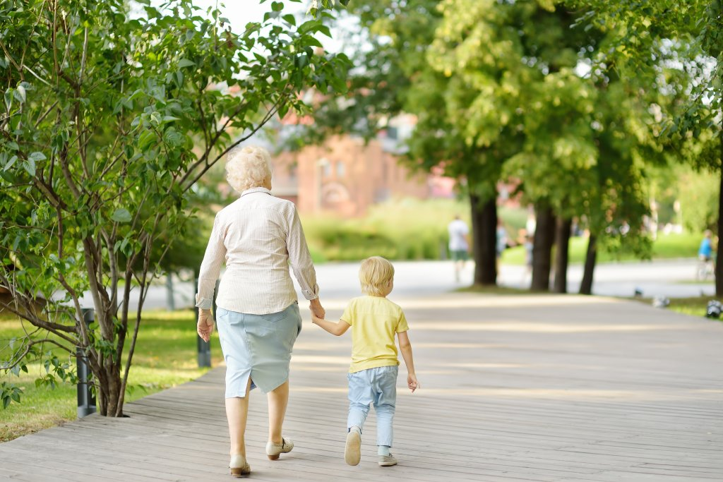 A grandmother walks with her grandchild